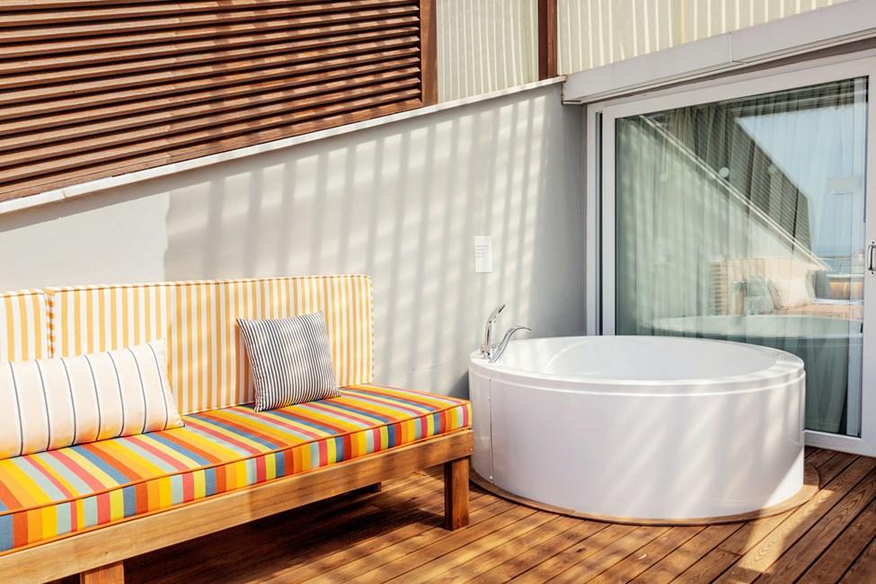 Penthouse Suite med balkong og havutsikt