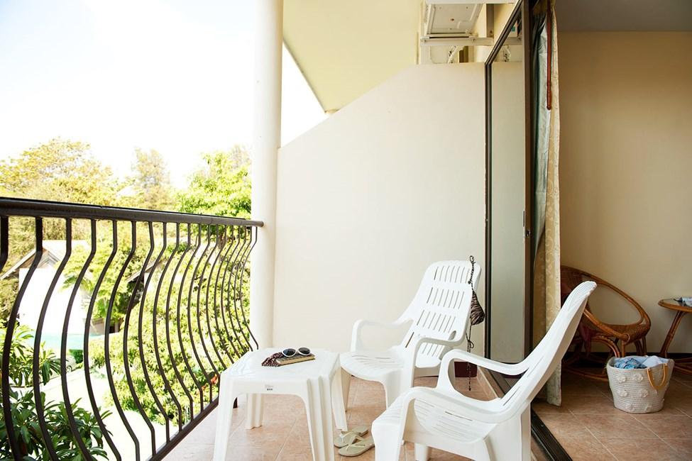 Dobbeltrom med balkong mot hagen