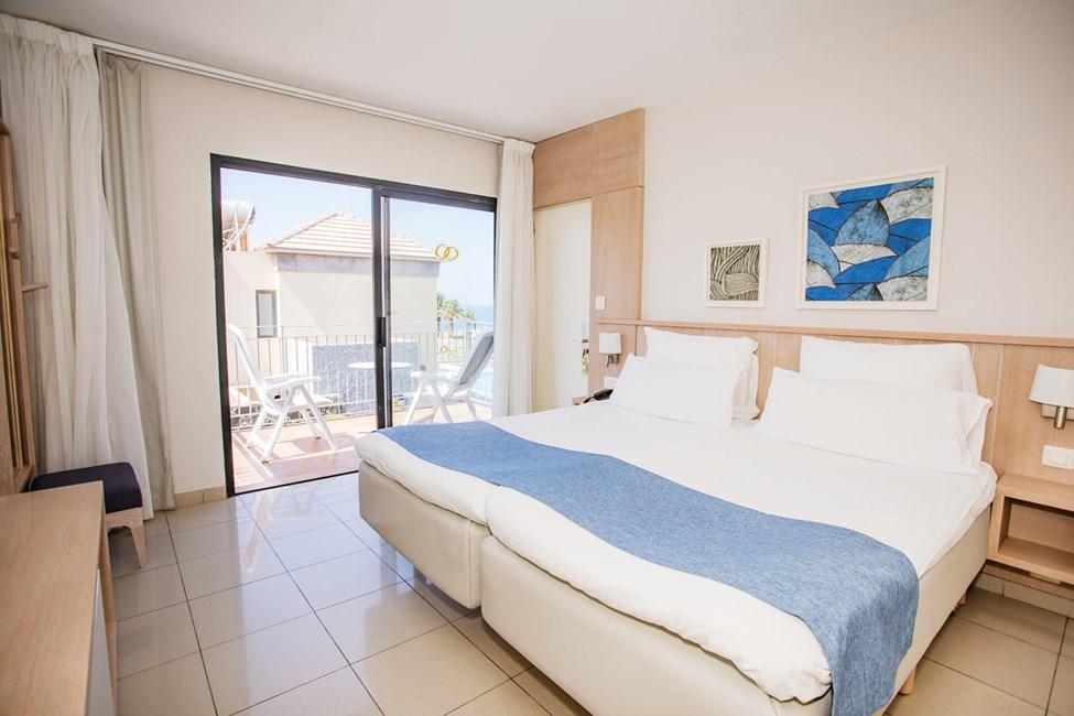 Soverommet i dobbeltrommene og 3-romsleilighet i to etasjer, med 4 ordinære senger