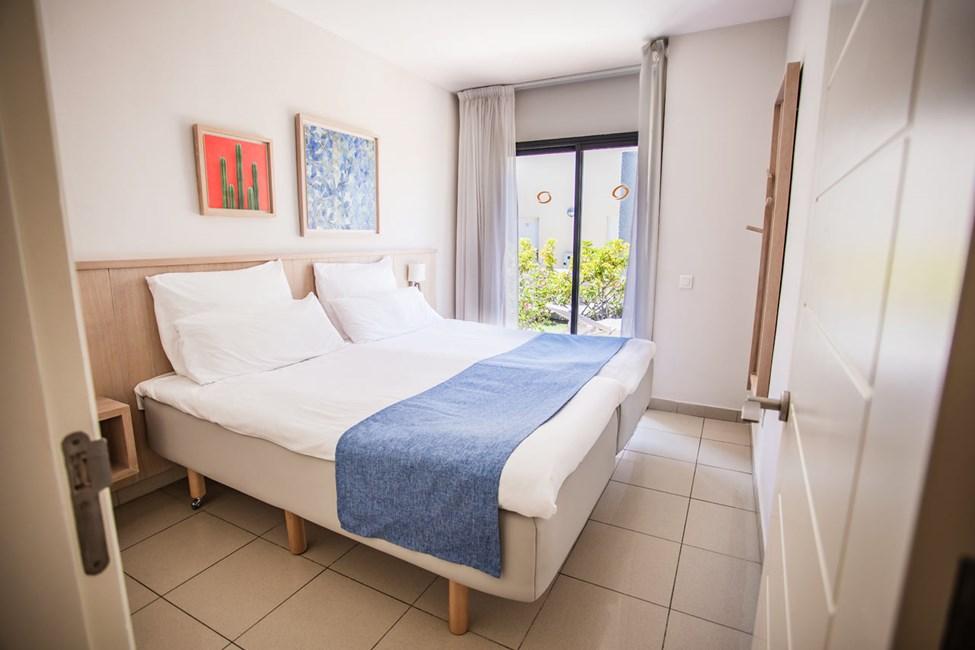 2-romsleilighet med terrasse og 3-romsleilighet i to etasjer, med 4 ordinære senger